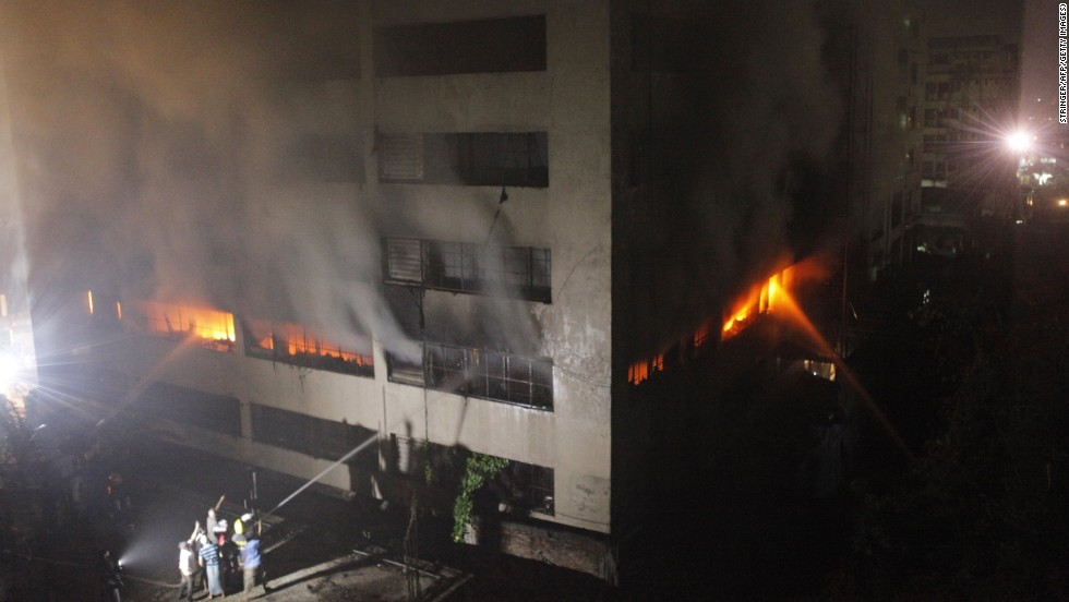 "Bangladeshi firefighters attempt to extinguish a blaze at a garment factory in Dhaka early on Thursday, May 9. At least seven people were killed in the latest tragedy in Bangladesh's textile industry. Bodies are still being  pulled from the rubble of <a href=""http://www.cnn.com/2013/04/24/asia/gallery/bangladesh-building-collapse/index.html"" target=""_blank"">a  garment factory that collapsed</a> on April 24, killing at least 900 people."