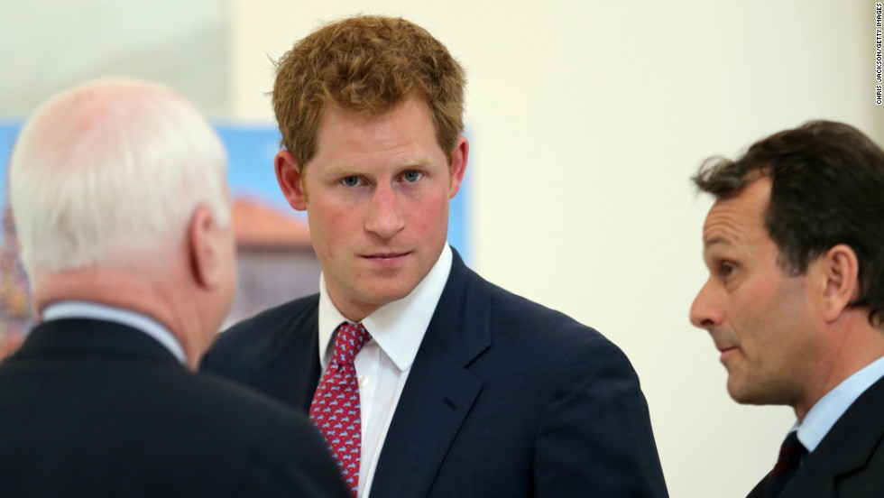 John McCain chats with Prince Harry and Guy Willoughby, right, of the HALO Trust. Eliminating landmines was a cause also championed by Harry's mother, the late Princess Diana of Wales.