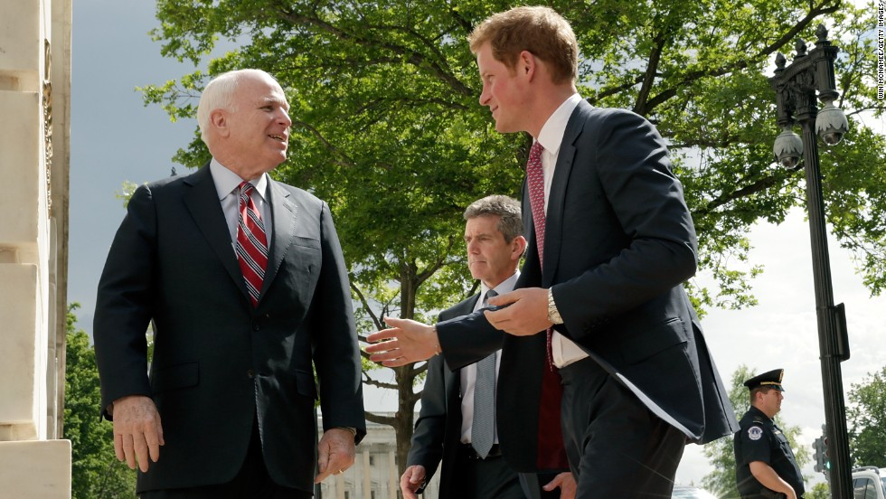 Harry greets Sen. John McCain after arriving on Capitol Hill during the first day of his trip to the United States.