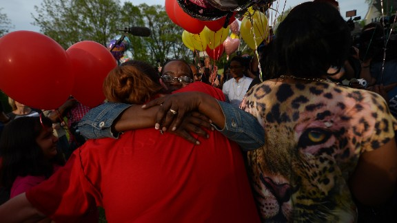 Residents gather outside a community meeting at Immanuel Lutheran Church on Thursday, May 9, to talk about the kidnapping case in Cleveland. Balloons were released as part of the ceremony.