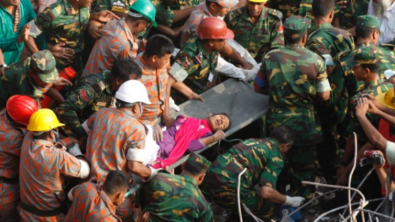 Rescue workers carry Reshma Begum, 19, to safety on Friday, May 10, a day after her discovery alive amid the wreckage of a building that had entombed her since it collapsed on April 24, in Dhaka, Bangladesh. At least 1,127 people have been confirmed dead from the garment factory building collapse.