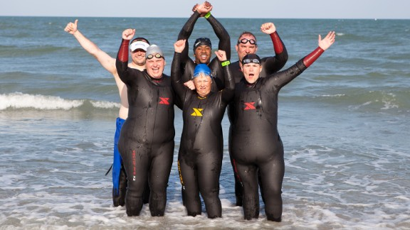 "The CNN Fit Nation ""6-Pack"" conquered the ocean in Clermont, Florida, on their midway training trip in May. Team members Tabitha McMahon, front row from left, Rae Timme  and Annette Miller and Douglas Mogle, back row, from left, Will Cleveland and Stacy Mantooth are training to race the 2013 Nautica Malibu Triathlon on September 8 alongside CNN"