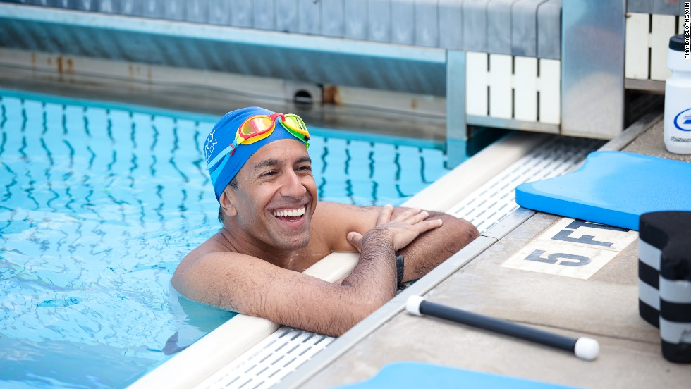 Gupta takes a short break during a swim workout.
