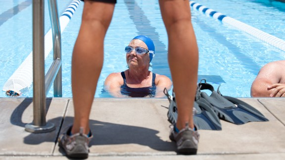 Using flippers during practice helps team members strengthen their kick and ankle flexibility.