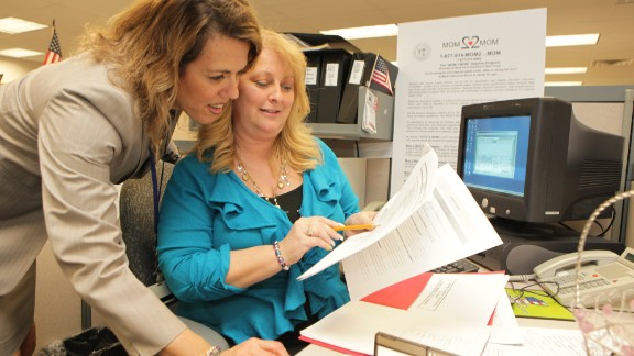 Mom2Mom founder Cherie Castellano, left, confers with peer counselor Dawn Dreyer Valovcin.