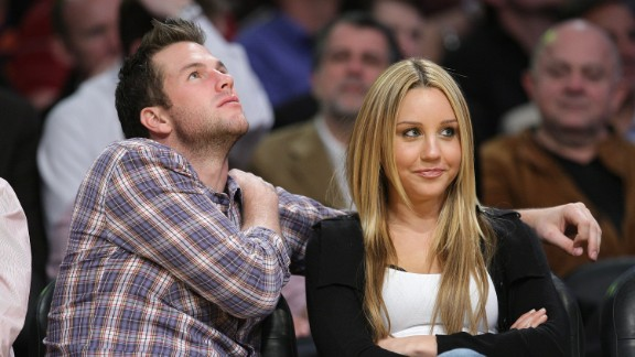 """While working on movies like """"Sydney White,"""" Bynes' personal life also took the spotlight. She was briefly linked to athlete and reality star Doug Reinhardt, here at a Los Angeles Lakers game in December 2008."""