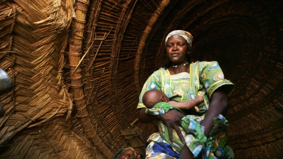 A woman holds her baby in a village in southern Niger, where progress in women's access to family planning is being made.