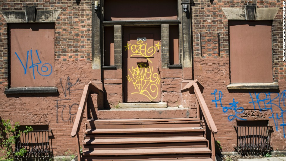 Around the corner from Seymour Avenue, graffiti is written on an abandoned building.