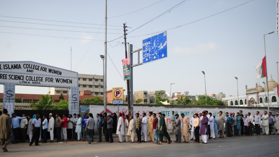 Pakistani voters queue for their turn to cast their ballots outside a polling station in Karachi on May 11, 2013.