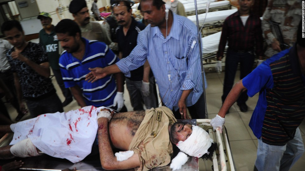 Men move a stretcher carrying an injured man at a hospital, following a bomb explosion in Karachi, Pakistan on May 11.