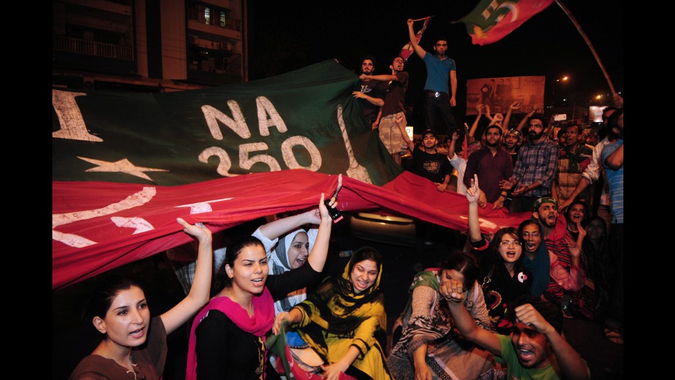 Supporters of Imran Khan shout slogans during a protest on May 12. Across the country, 29 people were killed in Election Day violence on May 11.