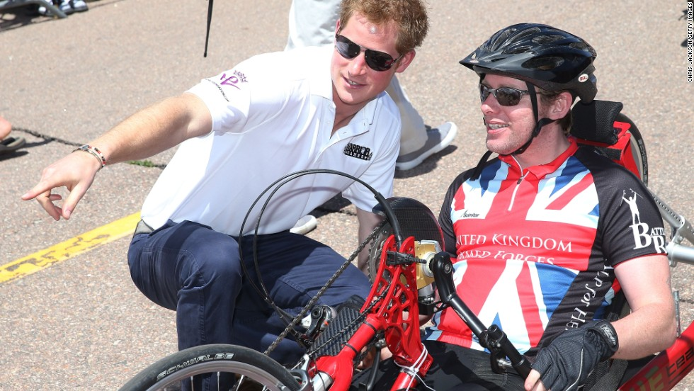 Prince Harry speaks to a competitor at the hand cycling event of the Warrior Games in Colorado Springs on May 12. The Warrior Games encompass athletic contests for wounded service personnel.
