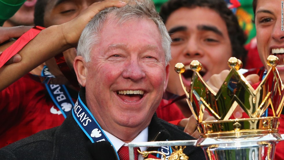 Alex Ferguson with the English Premier League trophy after Manchester United's 2-1 win over Swansea.