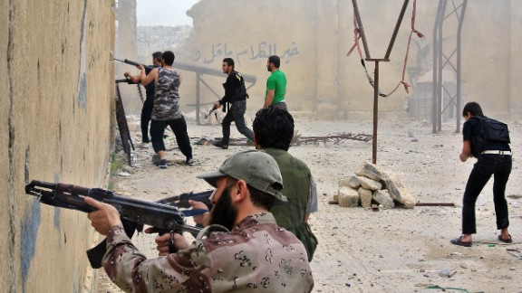 Rebel fighters fire at government forces in the northern Syrian city of Aleppo on Sunday, May 12.