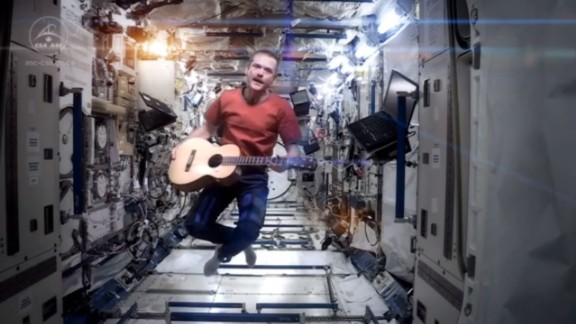 """Many space fans already know about Chris Hadfield, a Canadian Space Agency astronaut who just spent five months aboard the International Space Station. He's a bit of a social media star, with hundreds of thousands of fans on Facebook and Twitter. But his rendition of David Bowie's """"Space Oddity"""" is propelling him to further heights. The viral video is the latest of his many popular posts. Click through the gallery to see some other things Hadfield has shared via Twitter with the people of Earth, where he was scheduled to return the night of Monday, May 13."""