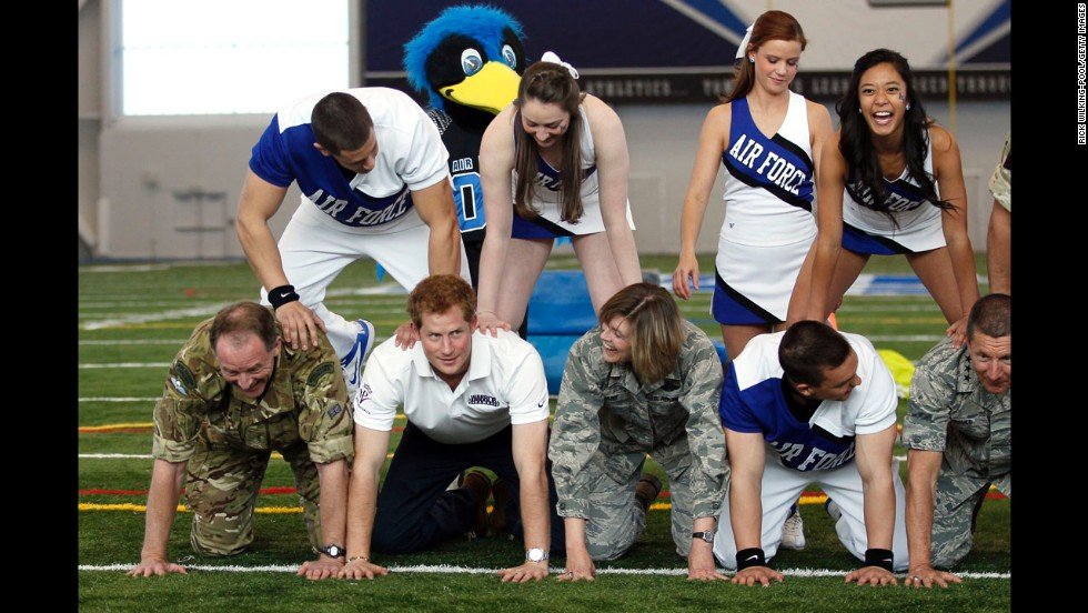 Prince Harry serves as a base in a pyramid formation at the U.S. Air Force Academy's football training center in Colorado Springs, Colorado, during the fourth day of his weeklong visit to the United States on Sunday.