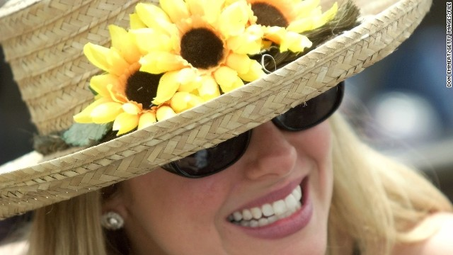 BALTIMORE, : Jaynee Kannan of Centerville, Virgina, wears a hat covered with Lazy Susans as she watches races 15 May 1999 at Pimlico Race track in Baltimore, MD. Today is the running of the 124th Preakness Stakes. (ELECTRONIC IMAGE) AFP PHOTO (Photo credit should read DON EMMERT/AFP/Getty Images)