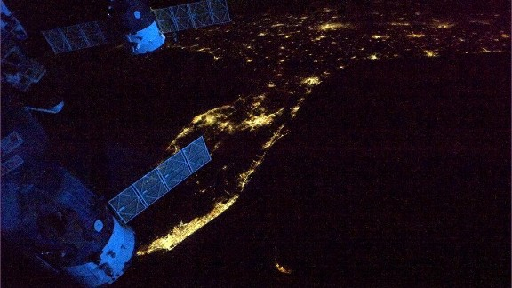"""A view of the Florida Peninsula at night. """"Spaceship's glowing blue in the dawn,"""" wrote Hadfield on May 12, """"as we leave Florida headed across the Atlantic."""""""