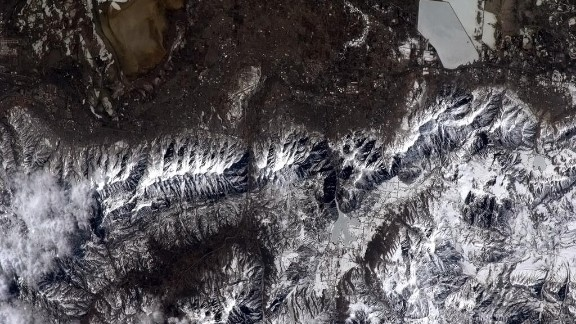 """This photo was taken over a snowy Utah. """"Next year, I'll get some skiing in,"""" Hadfield quipped."""