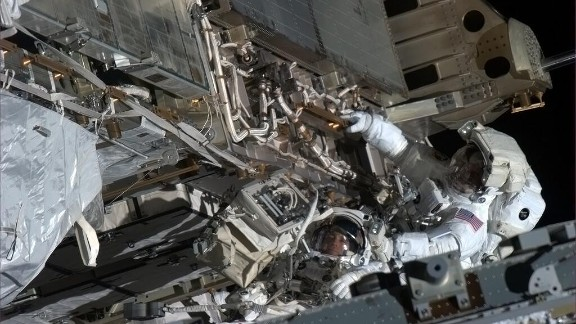 """""""Here's looking at you,"""" tweeted Hadfield about this spacewalk photo opportunity with Tom Marshburn, a flight engineer. """"Chris and Tom take a minute with visors to look up-sun at my camera in the window,"""" reads the May 11 post."""