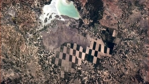 """A checkerboard scene below. """"Little farmers, big farmers and nature, in Turkey,"""" Hadfield wrote on May 8."""