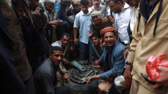 Yemenis surround one of the tyres of a Russian-made Yemeni military jet after it crashed in the capital Sanaa on May 13.