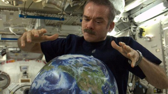 """For many fans of the """"Star Wars"""" franchise, May 4 has a special meaning. """"There is no try -- only do,"""" Hadfield wrote in a tweet. """"May the 4th be with you."""" He was of course referring to the famous line, """"May the force be with you"""" and is shown here playing with a miniature version of Earth."""