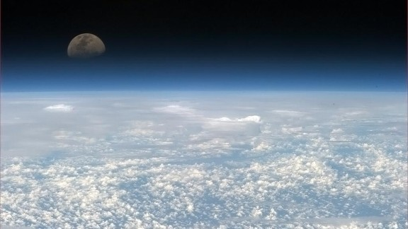 """Hadfield often posted a concluding image at the end of a night, and this is how he finished his posts for April 18: """"Tonight's Finale: Catching the moon rising takes patience, but is worth it."""""""
