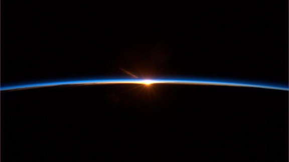 """At the very end of the trip, on May 13, Chris Hadfield tweeted this image: """"Spaceflight finale: To some this may look like a sunset. But it's a new dawn."""""""