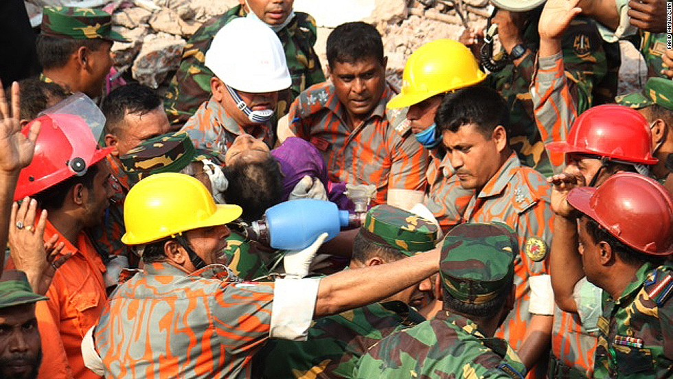 Begum is pulled alive from the rubble by the rescue workers on May 10, after being buried for 16 days.