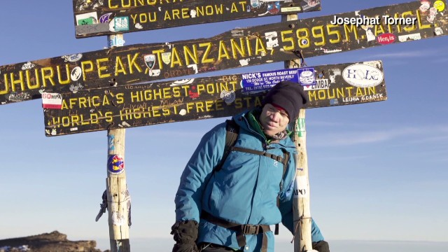 Albino rights activist climbs mountain
