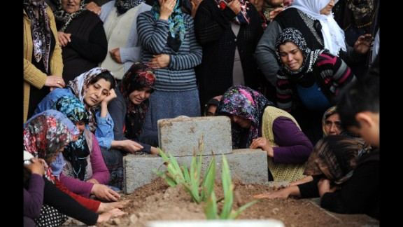 Relatives mourn at the grave of a bombing victim on May 12.  Residents of Reyhanli called on Turkey