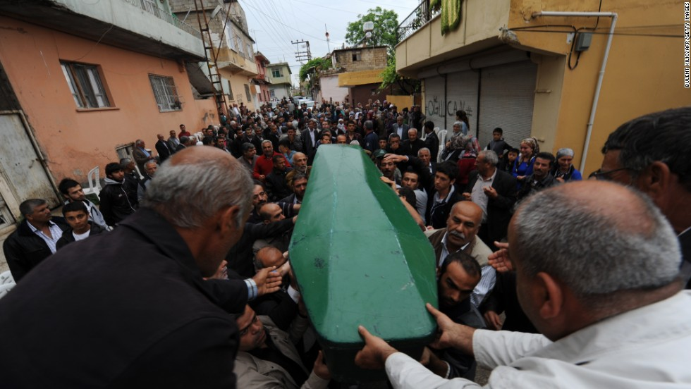 The body of Ogulcan Tuna, 18, is carried during the May 12 funeral for the bombing victims.