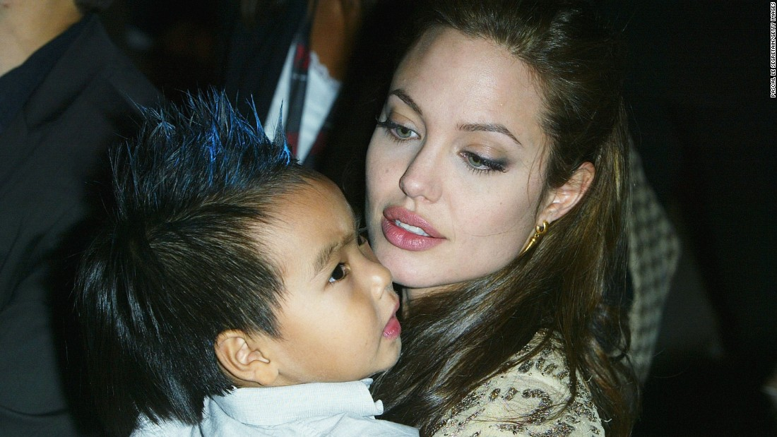 "Jolie carries her son Maddox at the world premiere of ""Shark Tale"" in September 2004."