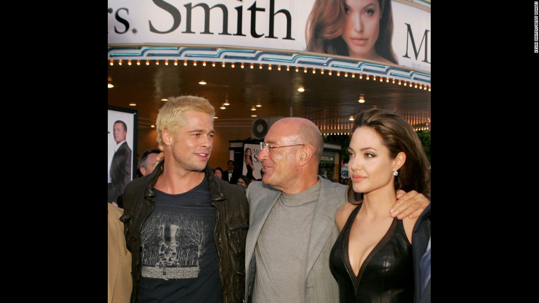 "Producer Arnon Milchan centers Jolie and Pitt at the premiere of ""Mr. & Mrs. Smith"" in June 2005."