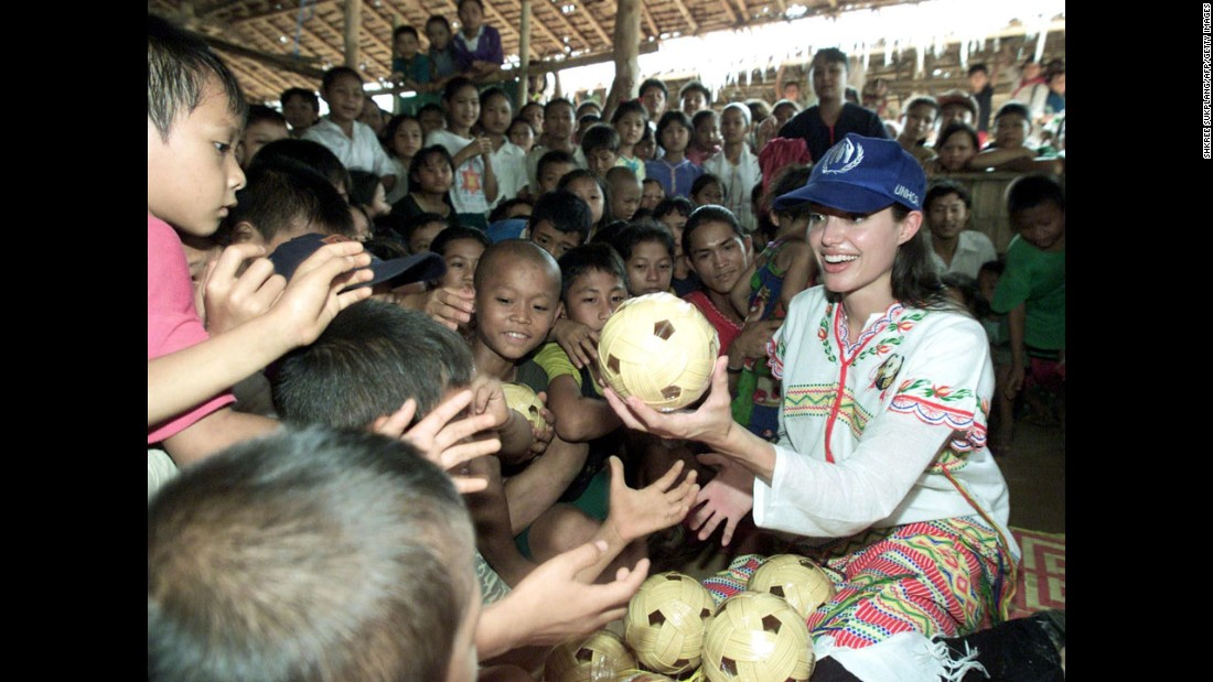 Jolie distributes balls to children at the Tham Hin refugee camp, on the Thailand-Myanmar border, in May 2002. She was a goodwill ambassador for the United Nations High Commissioner for Refugees before she became a special envoy for the agency in 2012.