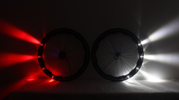A ring of white and red LEDs are installed around the entire rim of the front and back wheels, acting as headlights and taillights