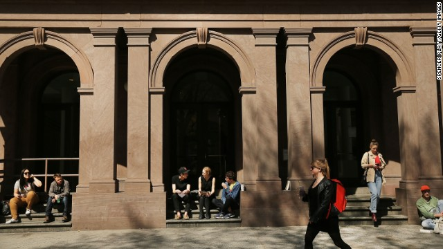NEW YORK, NY - APRIL 24: Students sit in front of Cooper Union for the Advancement of Science and Art, one of the last tuition-free colleges in the country, on April 24, 2013 in New York City. Cooper Union recently announced that for the first time in more than a century it will begin charging undergraduates to attend the school starting in the fall of 2014. While the school will not charge students in severe financial hardship, those that can will pay around $20,000 per year. (Photo by Spencer Platt/Getty Images)