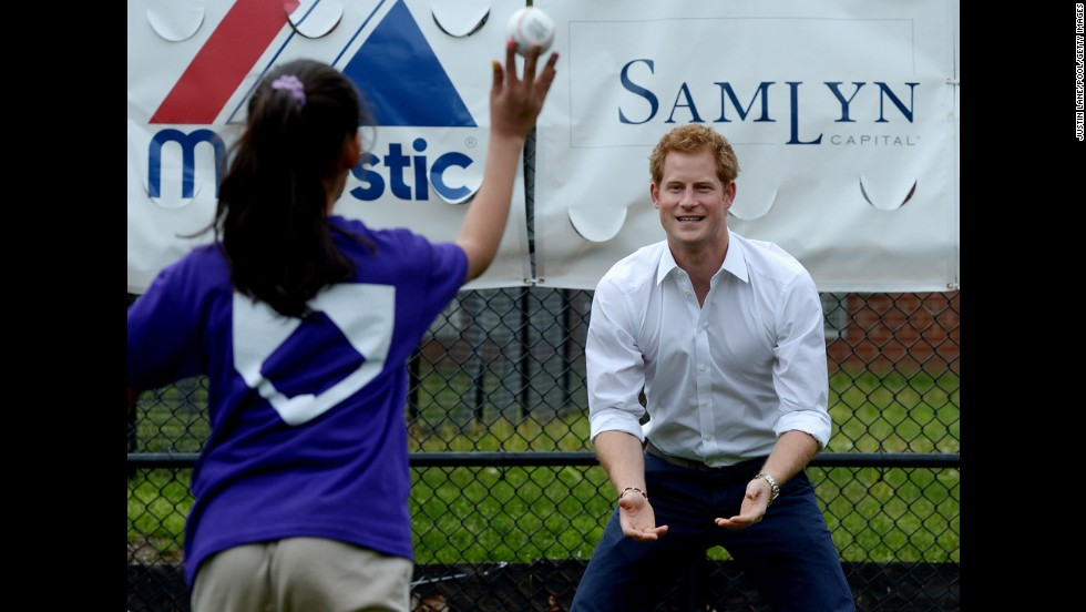 Prince Harry throws a baseball with a clinic participant on May 14. The clinic was part of a launch of a new partnership between the Royal Foundation of the Duke and Duchess of Cambridge and Harlem RBI.