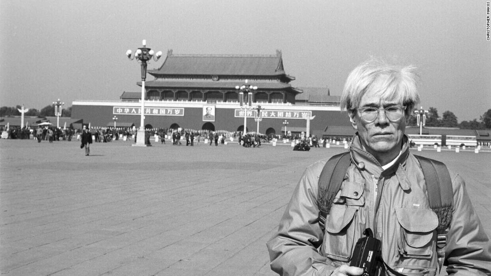 During his first and only trip in China, Warhol is pictured in front of Tiananmen Square in Beijing, with its iconic portrait of Chairman Mao in November 1982.