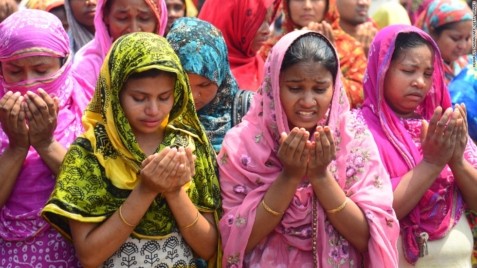 Relatives of missing garment workers offer prayers in front of the rubble on May 14 in Savar.