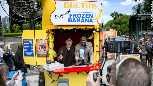 Ron Howard and Terry Crews work the Bluth's Original Frozen Banana Stand in New York on Tuesday.