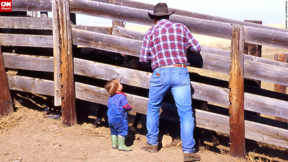 "To this day, blue jeans remain the uniform for cowboys young and old. Here, Bruce Beasley and his grandson <a href=""http://ireport.cnn.com/docs/DOC-971568"">load cattle on their farm</a> in Patricia, Alberta, in May 2013."