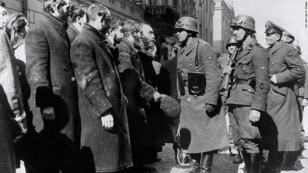 The revolt was crushed by German troops under the command of SS-Gruppenfuehrer Juergen Stroop during April and May 1943. Here German soldiers question prisoners after the uprising.