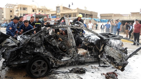 Rescuers work at the site of a car bomb attack in Kirkuk, about 250 kilometers north of Baghdad, on Wednesday.
