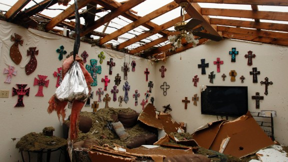 The living room of a Cleburne home is left without a roof on May 16.