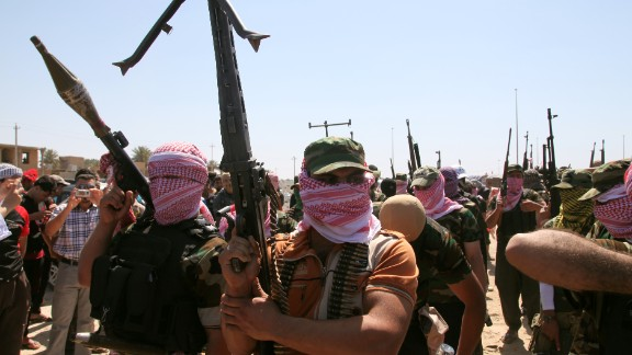 Iraqi anti-government gunmen from Sunni tribes in Anbar province march during a protest in Ramadi on April 26, 2013.