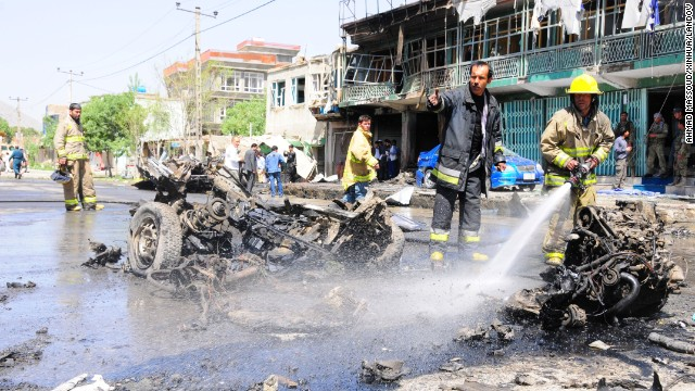 Firefighters work at the site of a suicide attack in Kabul, on Thursday, May 16.