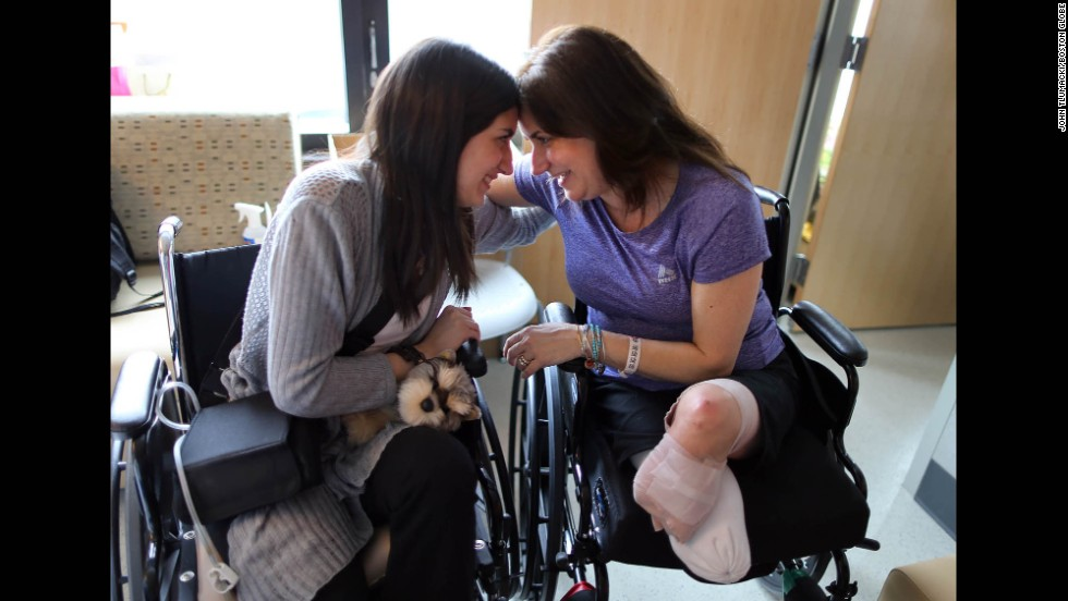 Sydney Corcoran and her mother Celeste, a day before Sydney's discharge from Boston's Spaulding Rehabilitation Hospital. Celeste Corcoran had to have both of her legs amputated.