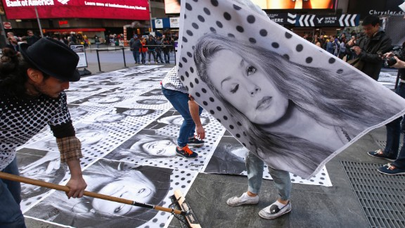 French street artist JR started the Inside Out project in 2011. He invites people around the world to submit portraits, share a statement about what they stand for and paste large-format prints in public spaces. The project has distributed more than 130,000 posters in over 100 countries. Pictured: New York, 2013.